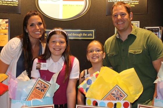 Grace (L) and Gabi (R) Hanna, Runners Up in Divisions Grades 3-5 & Grades K-2 respectively, and family