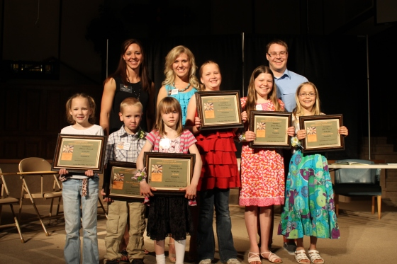 K-5 Division Alli Cwanek, Honorable Mention K-2; Isaiah Powers, Runner Up K-2; Sienna Smith, Winner K-2; Tori Cwanek, Honorable Mention, 3-5; Grace Hanna, Runner Up 3-5; Gabi Hanna, Winner, 3-5; Megan Powers, Director; Kara Reish, Director; Evan Fritz, Director