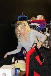 Sara Ward, who plays Lenore in afO's upcoming production of INTVERAL, gathers costumes before the show.