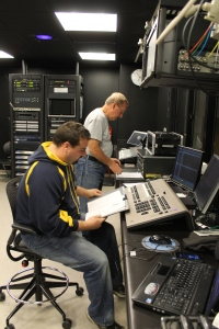 Jeff Salisbury and Ron Stauss in the tech booth making sure lights and sound run smoothly.